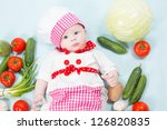 baby girl  wearing a chef hat...