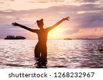 silhouette of happy slim girl...   Shutterstock . vector #1268232967