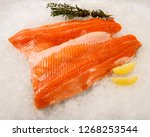 fresh salmon fillet on ice. | Shutterstock . vector #1268253544