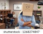 businessman hiding face inside... | Shutterstock . vector #1268274847