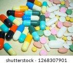 capsule pills and pill type... | Shutterstock . vector #1268307901
