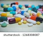 capsule pills and pill type... | Shutterstock . vector #1268308087