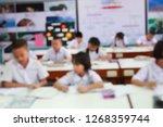 blur image of students... | Shutterstock . vector #1268359744