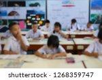blur image of students... | Shutterstock . vector #1268359747