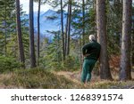 A Mountain Hiker In The...