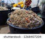 fishing nets along the quay of... | Shutterstock . vector #1268407204