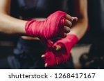 closeup of woman hands fist in... | Shutterstock . vector #1268417167