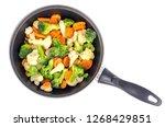 pan with frozen vegetable mix...   Shutterstock . vector #1268429851