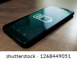 black smartphone with battery... | Shutterstock . vector #1268449051