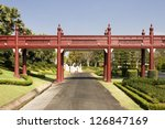 Red wood bridge in the park , Chiangmai Thailand - stock photo