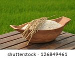 rice in bowl and paddy rice on... | Shutterstock . vector #126849461
