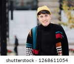 portrait of a handsome young... | Shutterstock . vector #1268611054