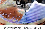 Small photo of Silicon wafer negative color in die attach machine in semiconductor manufacturing