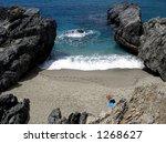 Taking a sun-bath on an isolated beach. - stock photo