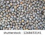 white pebble in concrete path....   Shutterstock . vector #1268653141