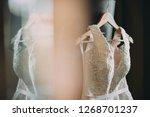 wedding dress of the bride.... | Shutterstock . vector #1268701237