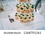 white wedding cake with flowers ... | Shutterstock . vector #1268701261