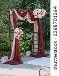 beautiful wedding archway. arch ... | Shutterstock . vector #1268701264