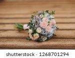 beautiful wedding bouquet of... | Shutterstock . vector #1268701294