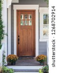 brown front door | Shutterstock . vector #1268702914