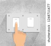 light switch. finger pressing... | Shutterstock .eps vector #1268711677