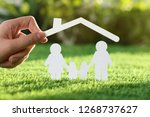 woman holding paper roof over... | Shutterstock . vector #1268737627