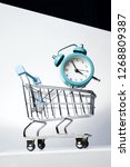 alarm clock and shopping... | Shutterstock . vector #1268809387