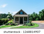 tiny house with well kept yard... | Shutterstock . vector #1268814907