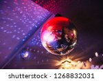 disco ball with bright rays ... | Shutterstock . vector #1268832031