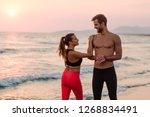 sportsman and sportswoman doing ... | Shutterstock . vector #1268834491