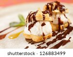 profiteroles with ice cream | Shutterstock . vector #126883499
