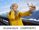 woman skier making selfie photo ... | Shutterstock . vector #1268928391