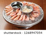 assorted shrimps on ice with... | Shutterstock . vector #1268947054