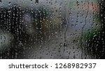 natural water drop on glass | Shutterstock . vector #1268982937