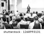 speaker giving a talk in... | Shutterstock . vector #1268993131