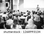 speaker giving a talk in... | Shutterstock . vector #1268993134