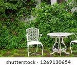 white alloy chair in the garden.... | Shutterstock . vector #1269130654