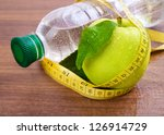 apple core  bottled water for... | Shutterstock . vector #126914729