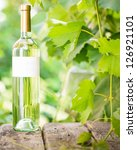 white wine bottles on old... | Shutterstock . vector #126921101