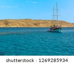 a sailing ship basks in the... | Shutterstock . vector #1269285934