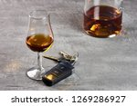 glass and bottle of whiskey on... | Shutterstock . vector #1269286927