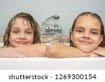 portrait of two girls taking a... | Shutterstock . vector #1269300154