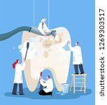 small doctors who treat giant...   Shutterstock .eps vector #1269303517