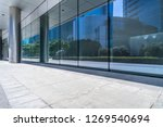 trees and buildings reflected... | Shutterstock . vector #1269540694