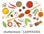 mix of spices in wooden spoon... | Shutterstock . vector #1269552301
