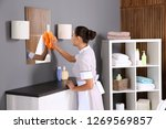 young chambermaid wiping dust... | Shutterstock . vector #1269569857