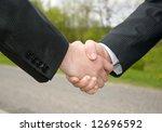 businessmen shaking hands | Shutterstock . vector #12696592