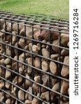 natural stone gabion | Shutterstock . vector #1269716284
