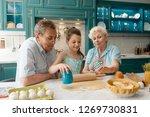 girl making cookies with... | Shutterstock . vector #1269730831