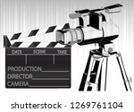 black movie clapperboard and... | Shutterstock .eps vector #1269761104